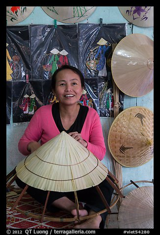 Woman making the Vietnamese conical hat. Hue, Vietnam (color)