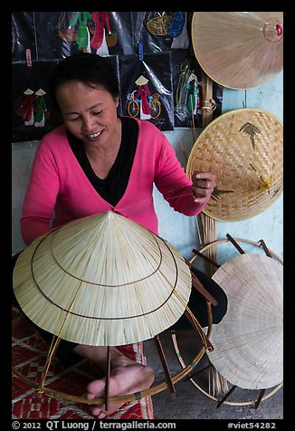 Woman crafting conical hat. Hue, Vietnam (color)