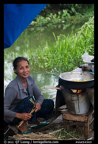 Woman cooking canalside, Thanh Toan. Hue, Vietnam (color)