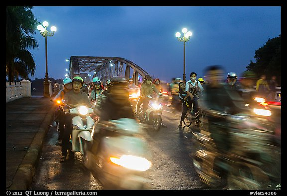 Night motorcyle traffic out of Trang Tien bridge. Hue, Vietnam (color)