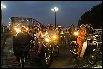 Mtorcylists by night, Trang Tien Bridge. Hue, Vietnam (color)
