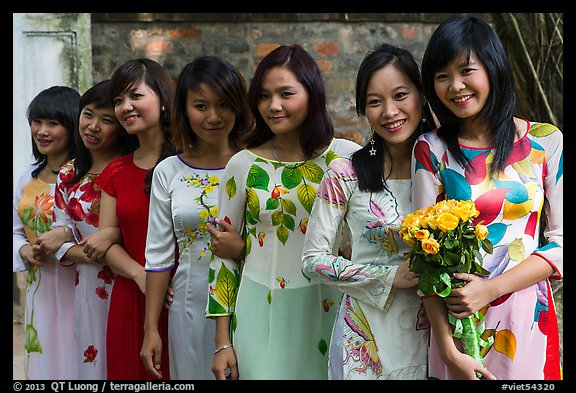 Row of women in Ao Dai, Temple of the Litterature. Hanoi, Vietnam (color)