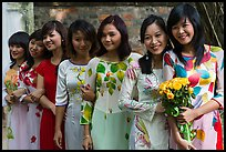 Row of women in Ao Dai, Temple of the Litterature. Hanoi, Vietnam ( color)