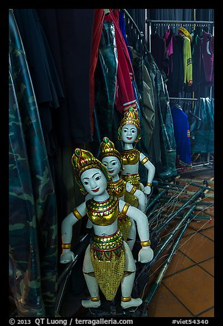 Water puppets controlled using long bamboo rods and string mechanism. Hanoi, Vietnam (color)