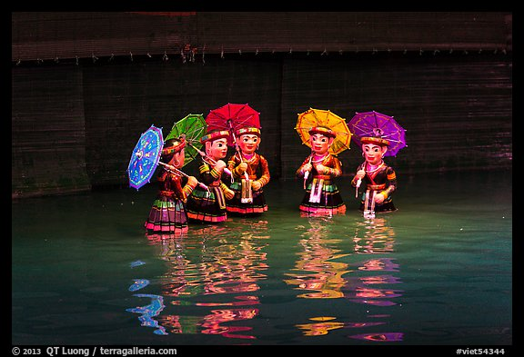 Water puppets (5 characters with umbrellas), Thang Long Theatre. Hanoi, Vietnam (color)