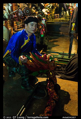 Water puppet artist holding dragon backstage, Thang Long Theatre. Hanoi, Vietnam (color)