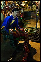 Water puppet artist holding dragon backstage, Thang Long Theatre. Hanoi, Vietnam ( color)