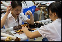Women in silk embroidery factory. Vietnam ( color)