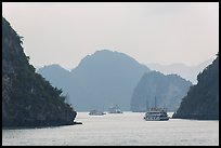 Tour boats and islands in mist. Halong Bay, Vietnam (color)