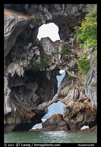 Openings through rocks. Halong Bay, Vietnam (color)