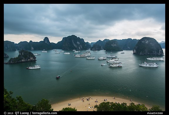 Crescent beach, boats and karst, Titov Island. Halong Bay, Vietnam (color)