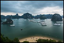 Crescent beach, boats and karst, Titov Island. Halong Bay, Vietnam ( color)