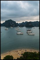 Elevated view of beach, boats and karst from Titov Island. Halong Bay, Vietnam ( color)