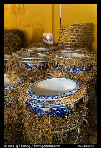Ceramic vases wrapped in hay in storeroom. Bat Trang, Vietnam (color)