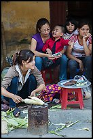 Woman roasting corn in the street. Bat Trang, Vietnam ( color)