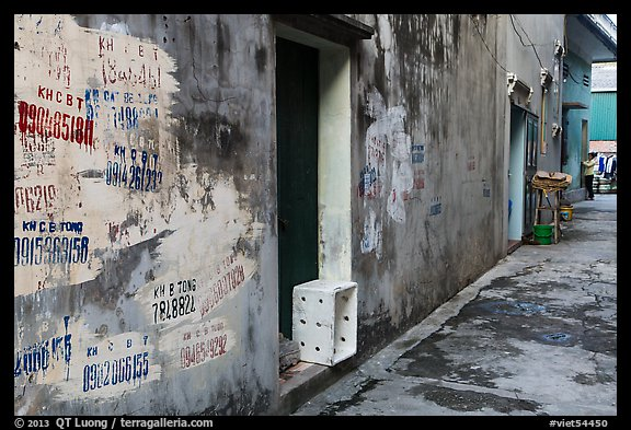 Alley with lots of painted numbers. Bat Trang, Vietnam (color)