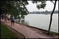 Walking for exercise around Hoang Kiem Lake at dawn. Hanoi, Vietnam (color)