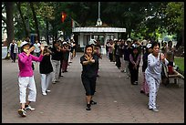 Women practising Tai Chi on shores of Hoang Kiem Lake. Hanoi, Vietnam (color)