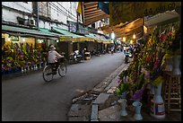 Street with flower sellers in early morning, old quarter. Hanoi, Vietnam ( color)