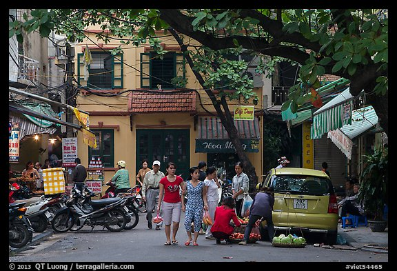 Early morning food shopping, old quarter. Hanoi, Vietnam (color)