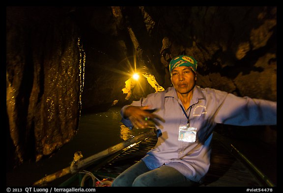 Woman boater in narrow cave passage, Trang An. Ninh Binh,  Vietnam (color)