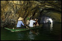 Boat rowed inside grotto passage, Trang An. Ninh Binh,  Vietnam (color)