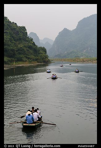 Boats in karstic lanscape of steep cliffs, Trang An. Ninh Binh,  Vietnam (color)