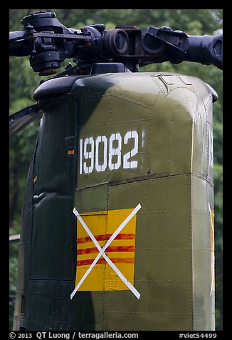Helicopter tail with crossed-out flag of South Vietnam, Hanoi Citadel. Hanoi, Vietnam (color)