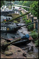 Tanks, helicopters, and warplanes, military museum. Hanoi, Vietnam ( color)