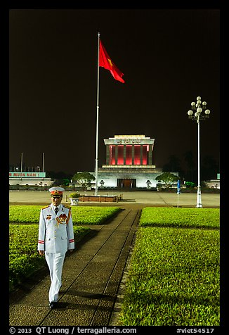 Officer walking in front of Ho Chi Minh Mausoleum. Hanoi, Vietnam (color)