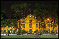 Colonial-area buildings bordering Ba Dinh Square at night. Hanoi, Vietnam (color)