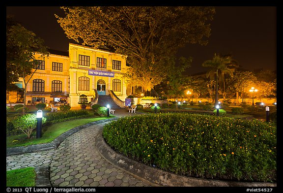 Public garden and French-area building at night. Hanoi, Vietnam (color)