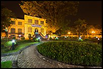 Public garden and French-area building at night. Hanoi, Vietnam ( color)