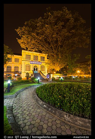 Public garden and library building at night. Hanoi, Vietnam (color)