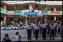 Schoolchildren in school courtyard, district 5. Ho Chi Minh City, Vietnam (color)