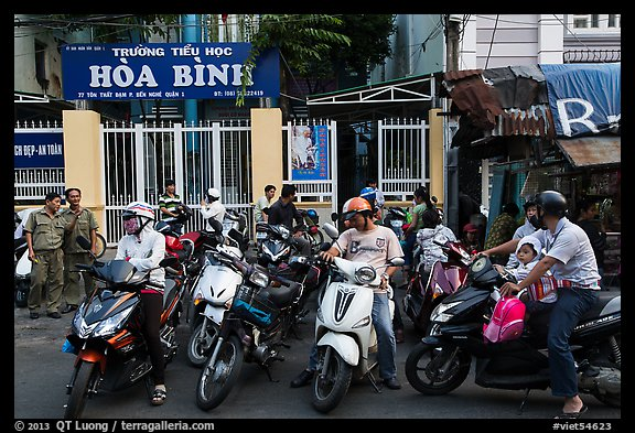 Parents waiting to pick up children in front of school. Ho Chi Minh City, Vietnam (color)