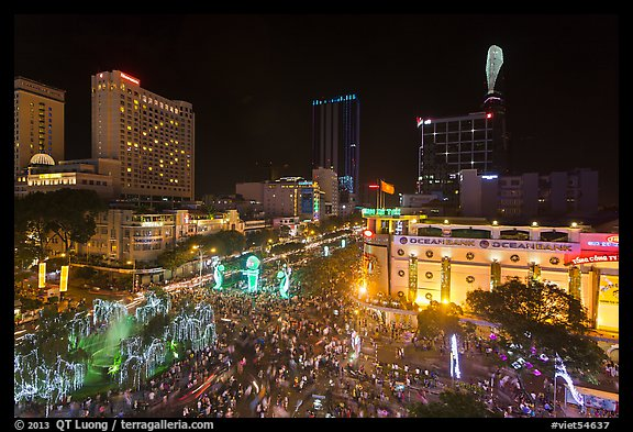 Crowded intersection at night from above, during holidays. Ho Chi Minh City, Vietnam (color)