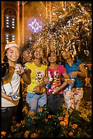 Young Revellers in front of Notre Dame Cathedral on Christmas Eve. Ho Chi Minh City, Vietnam ( color)