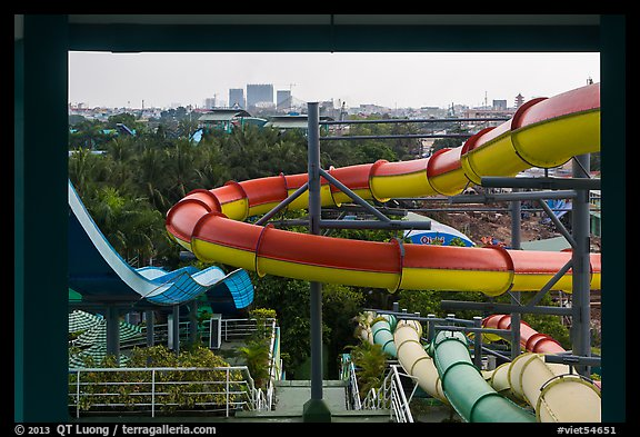 Water slides and skylines, Dam Sen Water Park, district 11. Ho Chi Minh City, Vietnam (color)