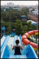 Woman on tall water slide, Dam Sen Water Park, district 11. Ho Chi Minh City, Vietnam (color)