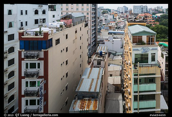 Rooftop view of skinny hotel buildings. Ho Chi Minh City, Vietnam (color)