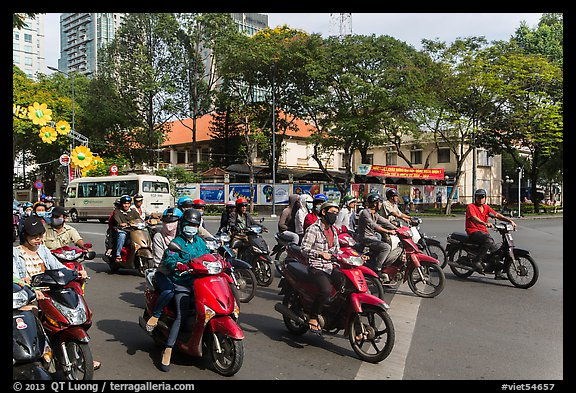 Motorbike riders waiting at intersection. Ho Chi Minh City, Vietnam (color)