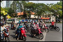 Motorbike riders waiting at intersection. Ho Chi Minh City, Vietnam ( color)