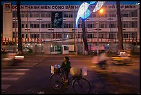 Vendor with bicycle at night. Ho Chi Minh City, Vietnam (color)