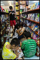 Children reading in bookstore. Ho Chi Minh City, Vietnam (color)