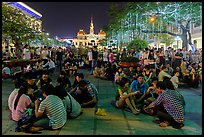 Groups in front of City Hall on New Year eve. Ho Chi Minh City, Vietnam (color)