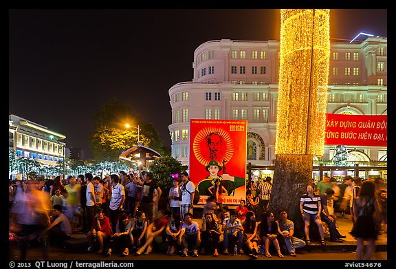 Revellers sitting on street, New Year eve. Ho Chi Minh City, Vietnam (color)