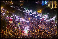 Le Loi boulevard with decorations and crowds from above. Ho Chi Minh City, Vietnam ( color)