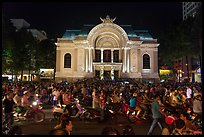 Crowds in front of Opera House at night. Ho Chi Minh City, Vietnam (color)