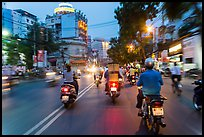 View from middle of street traffic at dusk. Ho Chi Minh City, Vietnam (color)
